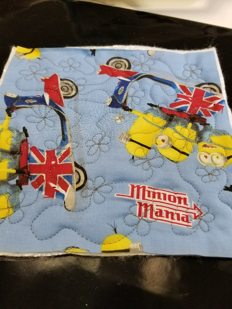 Practice Quilting makes quilted Minion potholders and One Monthly Goal-A Finish